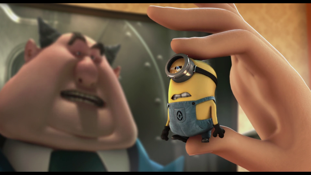 Gru uses shrink ray gun on Kevin shrinking him.